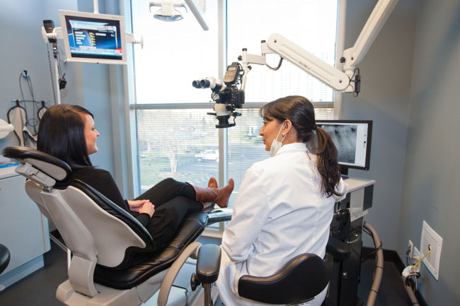 Dr. Chopra Consulting with Endodontics Patient